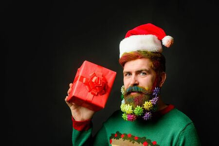 Christmas holidays and new year. Santa claus man with gift box. Christmas celebration holiday. Christmas beard decorations. Santa Claus wishes Merry Christmas. Funny bearded man in festive concept