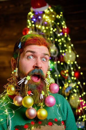 Surprised bearded man in festive concept. Santa Claus wish Merry Christmas. Theme Christmas holidays and new year. New year fashion clothes. Christmas celebration holiday. Christmas beard decorations