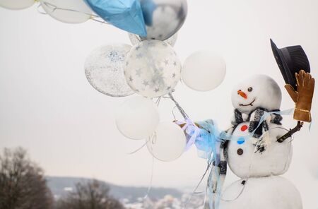 New year greeting card with snowman. Happy winter time. Snowman gentleman in stylish hat, scarf, gloves with air balloons. Hello winter. Greeting snowman. Snowman wish you merry Christmas. Snow men