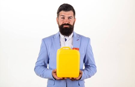 Bearded man holds can. In supermarket shop or DIY department store. Man holds petrol canister. Businessman holds oil canister. Man with plastic jerrycan in hand. Man holds plastic gallon or bottle. Archivio Fotografico - 133794004