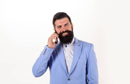 Smiling businessman calling with telephone. Businessman talking on mobile phone. Bearded businessman speak on phone. Emotional businessman talking on smart phone. Handsome man talking at cell phone Archivio Fotografico - 133794007