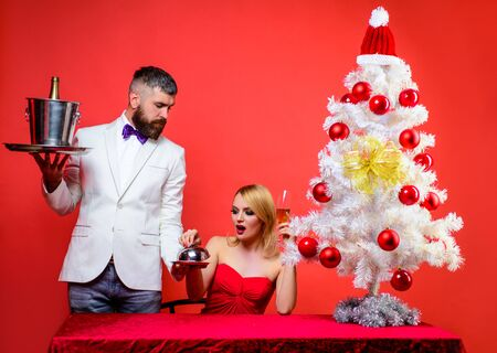 Romantic dinner in restaurant. Restaurant. Serving table. Couple in love at Christmas or New year. Romantic relationship. Merry Christmas. Happy New Year. Family, present, surprise, winter, happiness Archivio Fotografico - 134339787