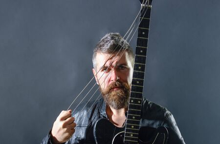 Attractive man with guitar. Fashionable guitarist with classic instrument. Music hobby. Guitar player in jacket with electric guitar. Rock or punk music concert. Bearded man with guitar. Concert tour Archivio Fotografico - 134339794