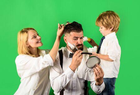 Barber shop tools. Hairstylist in barbershop. Hair Stylist and Barber. Beard care. Barbershop salon. Barbershop. Family business. Family barbershop. Assistant Archivio Fotografico - 134339818