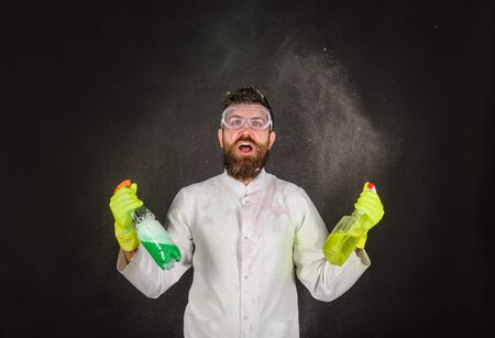 Cleaning advertising. Cleaners. Cleaning service and work concept. Bearded man with cleaning equipment. Bearded man with cleaning spray. Bearded man in uniform and rubber gloves holds cleanser spray Archivio Fotografico - 134339840