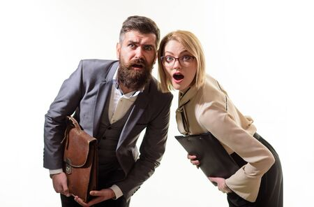 Surprised businesspeople holds folder and briefcase. Businessman in suit with suitcase. Businesswoman with folder. Business people with documentations. Surprised teachers, businessmen, office workers Archivio Fotografico - 134339843