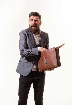 Elegant businessman in suit with briefcase. Fashionable man dressed in formal suit with briefcase. Businessman holds fashion men's leather briefcase. Business man in suit hold briefcase for documents Archivio Fotografico - 134339845