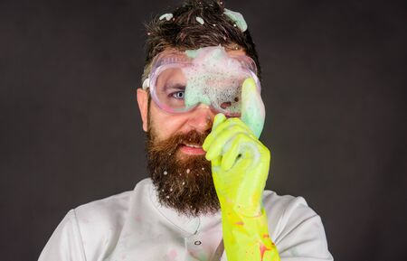 Bearded man with cleaning equipment. Man with foam on face. Cleaning advertising. Cleaners. Cleaning service and work concept Archivio Fotografico - 134339854