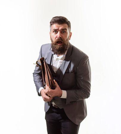 Businessman holds fashion men's leather briefcase. Elegant businessman in suit with briefcase. Business man in suit hold briefcase for documents. Fashionable man dressed in formal suit with briefcase Archivio Fotografico - 134339855