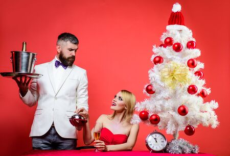 Merry Christmas. Family, present, surprise, winter, happiness. Couple in love at Christmas or New year. Romantic dinner in restaurant. Restaurant. Serving table. Romantic relationship. Happy New Year Archivio Fotografico - 134339864