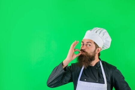 Professional chef showing delicious sign. Male chef in white uniform with perfect sign. Satisfied bearded chef, cook or baker gesturing excellent. Cook with taste approval gesture. Delicious sign Archivio Fotografico - 134339866