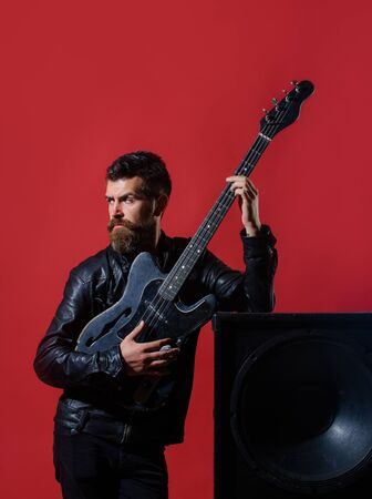 Rock or punk music concert. Concert tour. Attractive man with guitar. Fashionable guitarist with classic instrument. Music hobby. Guitar player in jacket with electric guitar. Bearded man with guitar Archivio Fotografico - 134339873