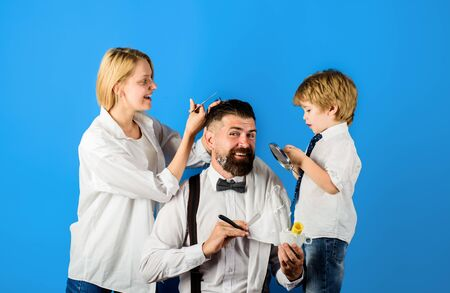 Bearded man in barbershop. Hairdresser and barber concept. Family day. Fathers day. Personal stylist barber. Barbershop salon. Barbershop. Family business. Family barbershop. Assistant