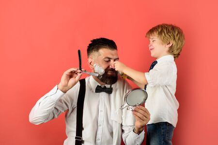 Barbershop salon. Assistant. Bearded man in barbershop. Hairdresser and barber concept. Personal stylist barber. Barbershop. Family business. Family barbershop. Family day Archivio Fotografico - 134339888