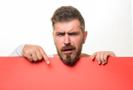 Man showing blank board with copy space for advertise. Attractive guy holds advertising banner. Serious bearded man holds blank billboard. Man holds empty placard. Businessman with blank poster Stok Fotoğraf - 134781040