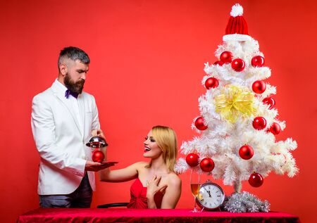 Family, present, surprise, winter, happiness. Couple in love at Christmas or New year. Romantic dinner in restaurant. Restaurant. Serving table. Romantic relationship. Merry Christmas. Happy New Year Stok Fotoğraf - 134781045