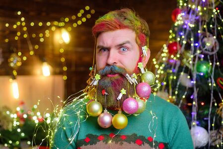 Christmas beard decorations. Winter holidays. New year party. Decorated beard. Bearded man with decorated beard. Christmas decoration. Christmas holidays. Surprised bearded man with decorated beard