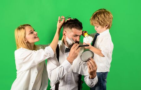 Assistant for dad. Personal stylist barber. Barbershop salon. Bearded man in barbershop. Hairdresser and barber concept. Family day. Father day concept. Barbershop. Family business. Family barbershop