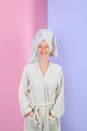 Spa. Bodycare concept. Beautiful woman after bath. Woman in towel and bathrobe. Spa woman in bathrobe and turban. Woman with perfect skin and bath towel on head. Smiling girl in bathrobe after shower 免版税图像