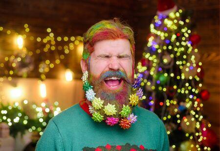 Decorated beard. Cheerful bearded man with decorated beard. New year party. Bearded man with decorated beard. Christmas decoration. Christmas holidays. Christmas beard decorations. Winter holidays