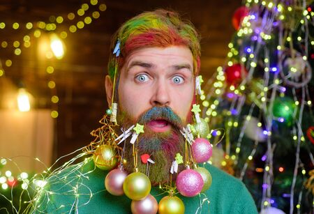 Surprised bearded man in festive concept. New year fashion clothes. Christmas beard decorations. Santa Claus wishes Merry Christmas. Christmas celebration holiday. Christmas holidays. Happy new year Stok Fotoğraf - 134781160