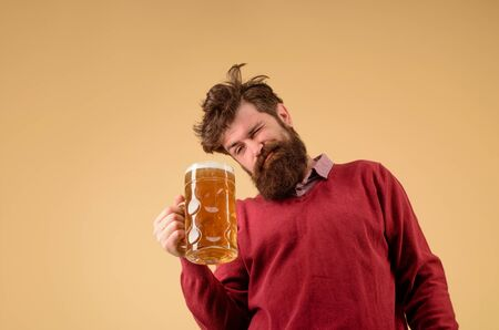 Celebration oktoberfest festival. Germany traditions. Brewery concept. Bearded man drinking beer. Pub and bar. Brewer. Craft beer. Bearded man hold glass with delicious beer. Beer in Germany. Alcohol 写真素材
