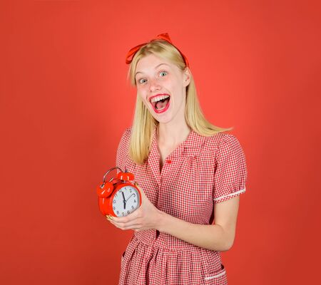 Time. Smiling woman with alarm clock. Shopping time. Season sales. Discount. Beautiful blond girl holds retro alarm clock. Happy smiling pinup girl hold alarm clock. Saving time concept. Black friday