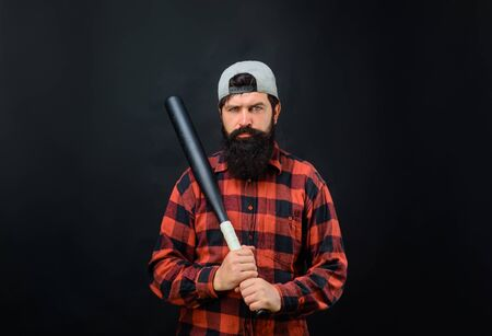 Sport. Bearded man with baseball bat. Power and energy concept. Sport equipment. Professional baseball player with baseball bat. Bearded man in plaid shirt holds baseball bat. Sport, training, health