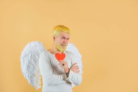 Happy Valentine's Day. February 14. Cupid with heart. Valentines day. Man in angel costume. Cupid. Amour. God of Love. Concept of Valentines Day Stock fotó