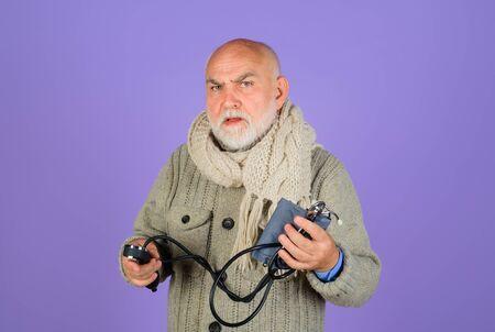 Pressure. Old man checking arterial blood pressure. Health care. Sphygmomanometer. Healthcare concept. Serious old man with sphygmomanometer