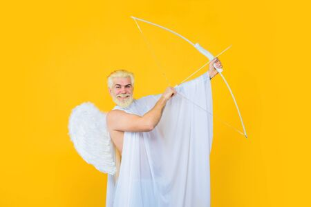 Valentines Day concept. Cupid angel with bow and arrows. Cupid in valentine day. Arrow of love. Cupid throws arrow with bow for valentine day. Male angel with bow and arrow. Valentines day cupid Stok Fotoğraf