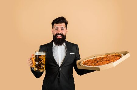 Restaurant or pizzeria. Bearded man with tasty pizza and beer in hands. Smiling man with beard holds delicious pizza in box and cold beer. Fast food. Italian food. Pizza time. Pizza delivery concept