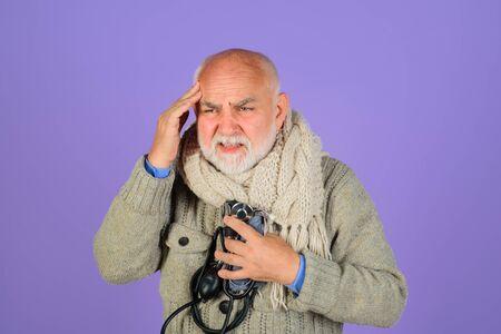 Checking old man arterial blood pressure. Health care. Sphygmomanometer. Severe headache. Healthcare concept. Headache. Old man with sphygmomanometer. Pressure