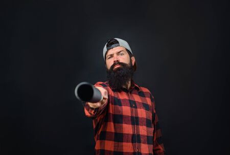 Sport, training, health. Bearded man pointing at you with baseball bat. Sport equipment. Power and energy. Professional baseball player with baseball bat. Bearded man in plaid shirt hold baseball bat