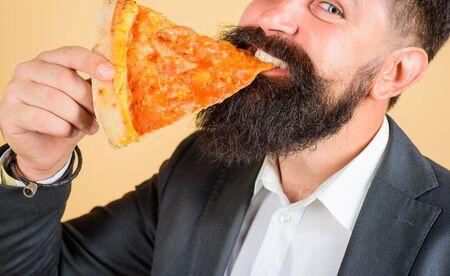 Closeup portrait of pizza slice. Lunch or dinner. Bearded man eating slice of pizza. Bearded man eating pizza. Man eating pizza slice. Delicious fast food meal. Italian cuisine concept Stok Fotoğraf