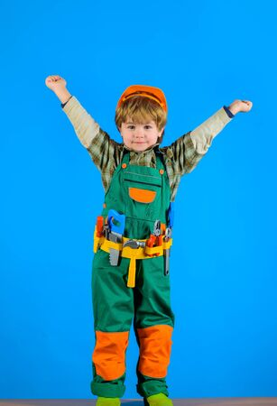 Worker with tools. Repair. Little boy in builder uniform with tools belt. Little kid repairman. Builder boy in helmet and toolbelt. Happy boy with tools for building. Child toys