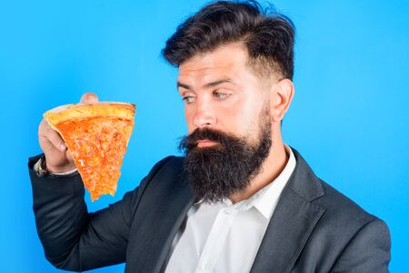 Bearded man hold slice of pizza. Fastfood. Bearded man eating pizza. Man eat fresh pizza slice. Delicious fast food. Italian cuisine concept. Tasty pizza at restaurant. Lunch or dinner