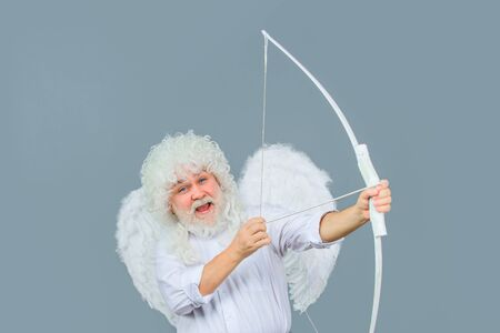 Cupid angel with bow and arrows. Symbol of love. Happy Valentines Day. Smiling man in angel costume. Stock Photo