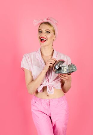 Portrait of woman with dollar banknotes on serving tray. Banknotes. Credit. Taxes. Money. Cash. Necessary. People savings. Loan payment. Smiling pin up girl with dollar banknotes