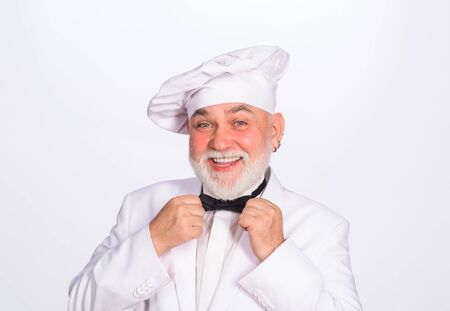 Cooking and food concept. Chief cook and professional culinary. Male chef. Food concept. Bearded chef in uniform, hat and bow tie. Professional chef, cook or baker. Chef man in uniform adjust bow tie