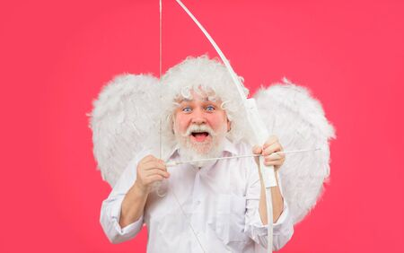 Valentines day card. Valentines cupid. Angel man with white wings. Cupid with bow and arrows. Love concept. Valentine angel. Handsome male angel Cupid. Bearded man with angel wings. Valentines Day