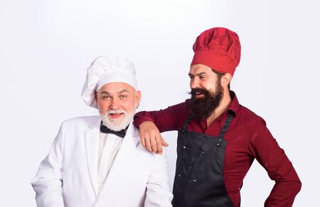 Two chefs cooking. Chefs in uniform. Healthy food. Chief cook and professional culinary. Professional cook men. Chef, cook or baker men. Chefs ready to cooking new dish. Professional culinary. Cook Zdjęcie Seryjne