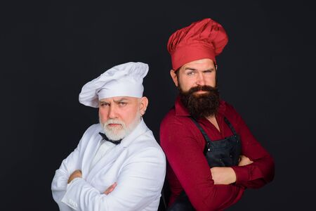 Two chefs on kitchen. Chefs in uniform. Healthy food. Chief cook and professional culinary. Professional cook men. Chef. Cook or baker. Chefs ready to cook. Professional culinary