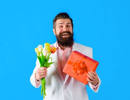 Smiling man hold valentines present and flowers. Valentines Day. Happy Valentine's Day. February 14. Stock fotó