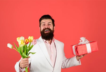 Bouquet of flowers. Smiling man hold valentines present and flowers. Valentines Day. Happy Valentine's Day. February 14.