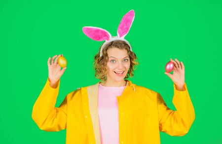 Spring holidays. Easter Holidays. Eggs hunt. Happy Easter. Egg hunt. Woman with rabbit ears holds Easter egg. Woman with bunny ears holds Easter egg. Rabbit girl. Spring time
