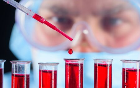 Doctor works with blood test in lab hospital. Laboratory testing patient's blood. Clinical laboratory. Laboratory assistant analyzing blood sample. Clinical laboratory test. Medical research. Closeup Standard-Bild