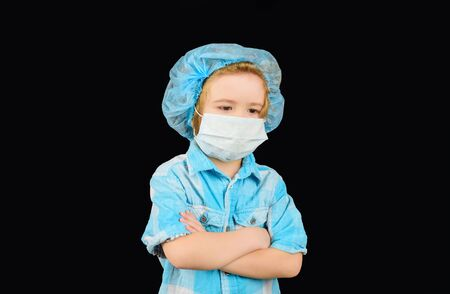 Cute boy in medicine healthcare mask. Little doctor in mask. Child boy with face mask protection. COVID-19. Coronavirus epidemic. Kid doctor or patient in antiviral mask. Protection from infection