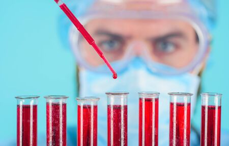 Medical concept. Technician works with blood test tubes. Blood samples of patients in laboratory in hospital. Medical, pharmaceutical and scientific research. Scientist works with test tubes. Closeup