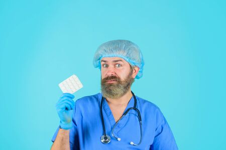 Doctor with pills. Medicine. Nurse. Package of pills. Treatment pill. Pharmaceutical drug. Bearded doctor. Smiling doctor with pills. Healthcare, medical care, hospital and pharmacy concept.